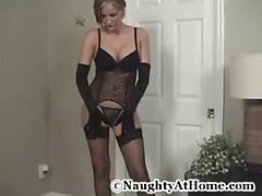 Housewife showing off her black lingerie for hubby