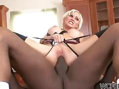Fascinating blonde milf gets tempted by a black dude