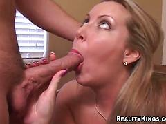 BLonde cougar takes a cock in her filthy mouth in a reality porn video