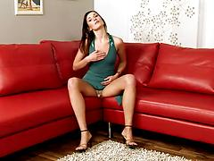 Slender beauty go for a kinky solo action on a red sofa